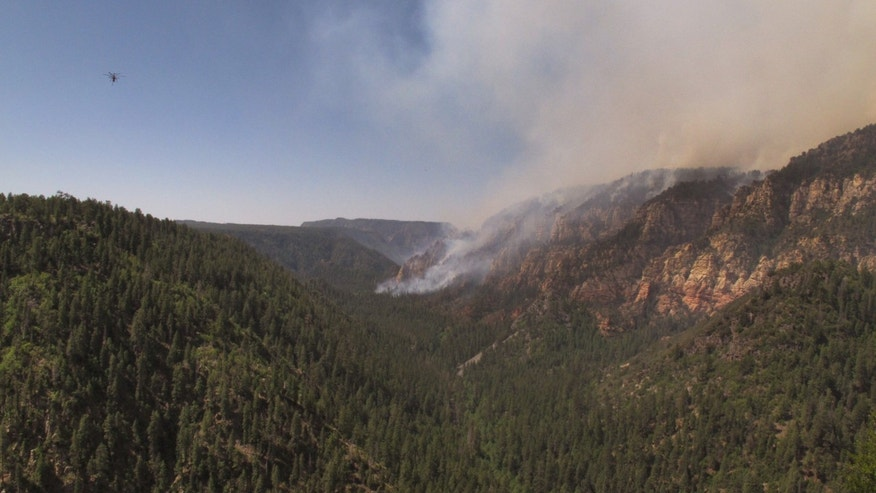 May 21, 2014: A wildfire burning in Oak Creek Canyon in northern Arizona has forced people out of the popular recreation area.