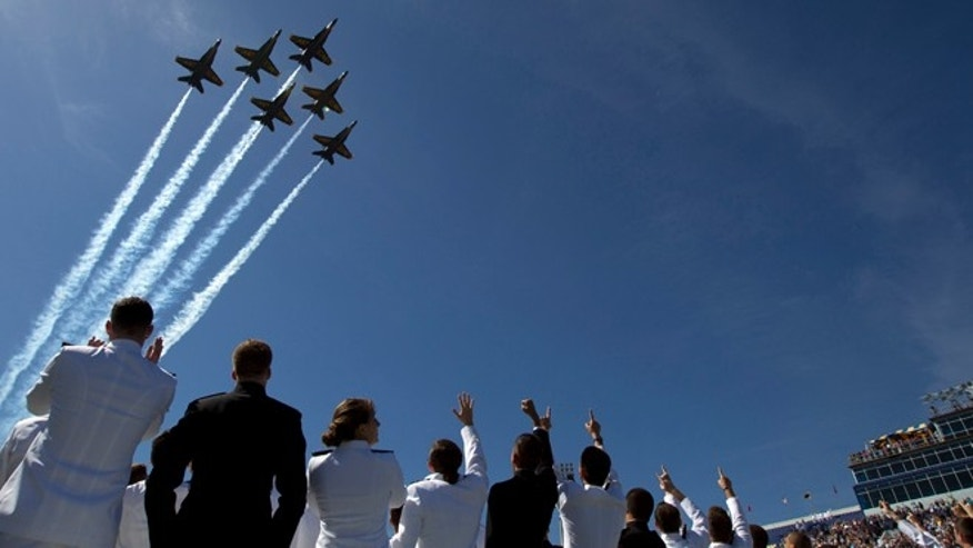May 23, 2014: U.S. Navy flight demonstration team, The Blue Angels perform a flyover above graduating Midshipmen during the United States Naval Academy 2014 Class graduation and commissioning ceremonies at Navy-Marine Corps Stadium in Annapolis, Md. (AP)