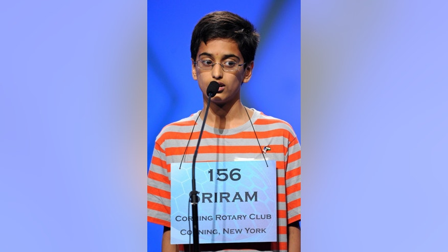"FILE - In this May 30, 2013 file photo, Sriram Hathwar, 13 of Painted Post, N.Y., spells ""flaneur"" during the semifinal round of the Scripps National Spelling Bee in Oxon Hill, Md.   (AP Photo/Cliff Owen)"