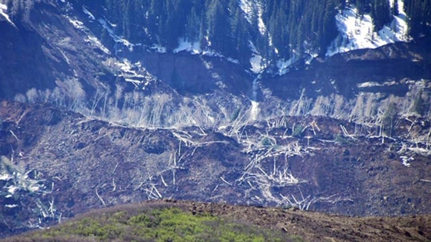 May 26, 2014: The results of a three-mile long mudslide are seen on Grand Mesa, where the slide started, in a remote part of western Colorado near the small town of Collbran. Rescue teams are searching for three men missing after a half-mile stretch of a ridge saturated with rain collapsed. (AP Photo/Mesa County Sheriff's Office)