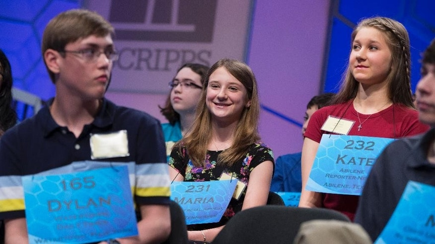 "Maria Kaltchenko of Tupelo, Miss., smiles after spelling the word ""pointelle"" correctly during the semifinal round of the National Spelling Bee, on Thursday, May 29, 2014, in Oxon Hill, Md. (AP Photo/ Evan Vucci)"