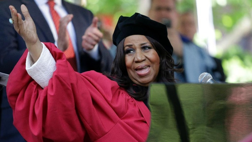 Singer Aretha Franklin performs the national anthem during Harvard's commencement ceremonies, Thursday, May 29, 2014, in Cambridge, Mass. Franklin was presented with an honorary degree during the ceremony. (AP Photo/Steven Senne)