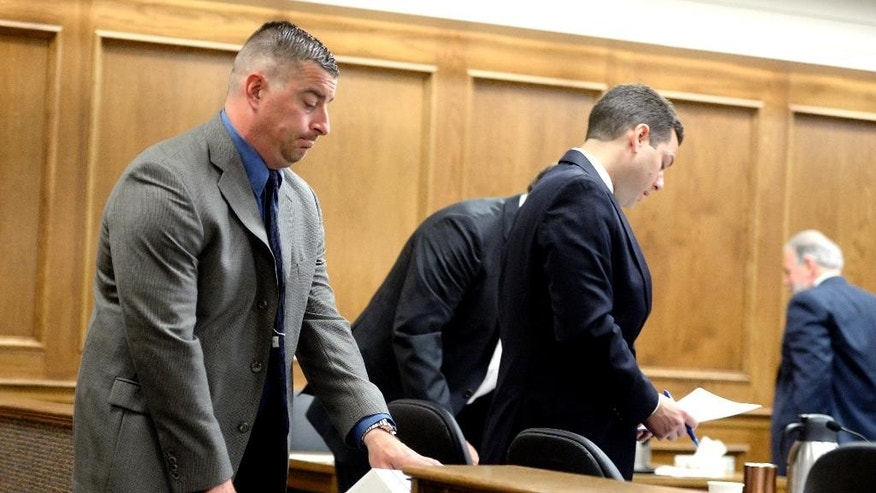 Former Boulder police Officer Sam Carter, left, enters the courtroom in Boulder, Colo.,  Wednesday, May 28, 2014, for day two of jury selection in his trial for the shooting of an elk. Prosecutors say a former Boulder, Colorado, police officer shot and killed an elk while on duty so he could mount its head on a wall as a trophy.  (AP Photo/The Daily Camera, Mark Leffingwell) NO SALES