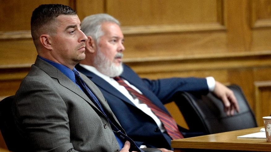 Sam Carter, left, and his defense attorney Marc Colin, right, listen to Fred Johnson's opening statement in Sam Carter's trial in Boul;der, Colo., Wednesday May 28, 2014, for the shooting and killing an elk while on duty so he could mount its head on a wall as a trophy.    (AP Photo/The Daily Camera, Mark Leffingwell) NO SALES