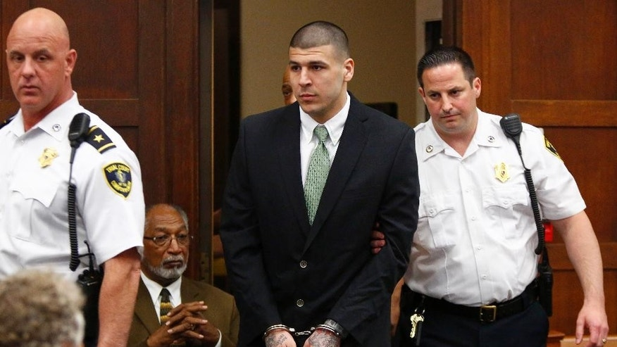 Hernandez is led into the courtroom to be arraigned at Suffolk Superior Court in Boston, Wednesday, May 28, 2014.