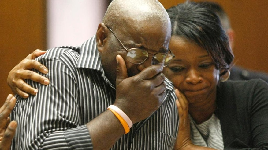 James Moore, left, whose daughter Jessica Moore was killed by Nicholas Welch in 2010, is comforted by his sister Cynthia Moore, as he breaks down while addressing the court at Welch's sentencing proceedings, Friday, May 30, 2014 in Newark, N.J. Welch was sentenced to life plus 20 years for killing Jessica Moore and wounding four others at an off-campus party near Seton Hall University. (AP Photo/Star-Ledger, Patti Sapone, Pool)
