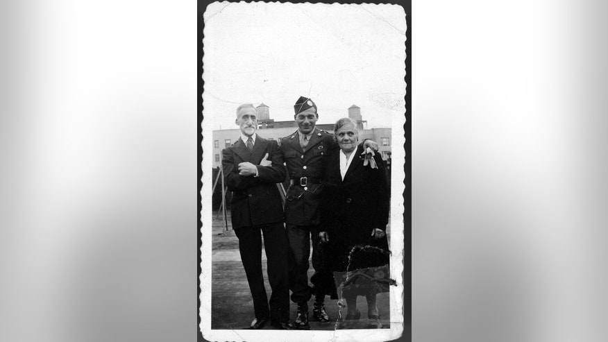 This 1940s era photo provided by Beth J. Harpaz shows her father David Jackendoff, in Army uniform, posing with his parents, Harry and Bella, in New York. Jackendoff parachuted into Normandy with the 101st Airborne on D-Day, June 6, 1944. Though he died in 1993, wartime radio interviews with him and a TV interview on the 40th anniversary of D-Day preserved his stories. (AP Photo/Courtesy of Beth J. Harpaz)