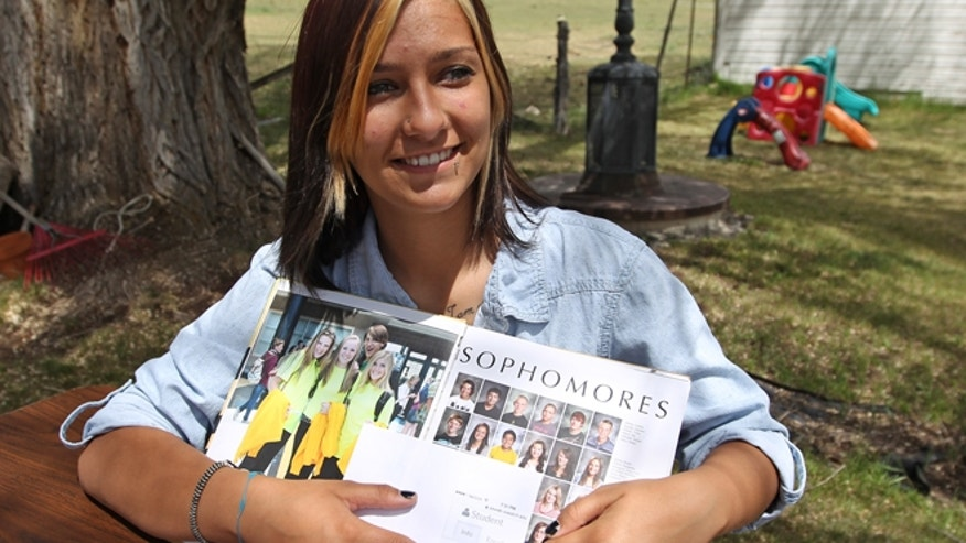 May 29: Wasatch High School sophomore Shelby Baum, 16, points to yearbook proof and her altered school yearbook photo.