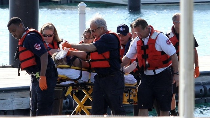 June 1, 2014: A woman is rescued from the South Side stretch of Lake Michigan after a boat she was in capsized Saturday night miles from Chicago's shoreline. The woman was later pronounced dead at a local hospital. The U.S. Coast Guard said crews are searching for as many as four other people. (AP Photo/Sun-Times Media, Alex Wroblewski)
