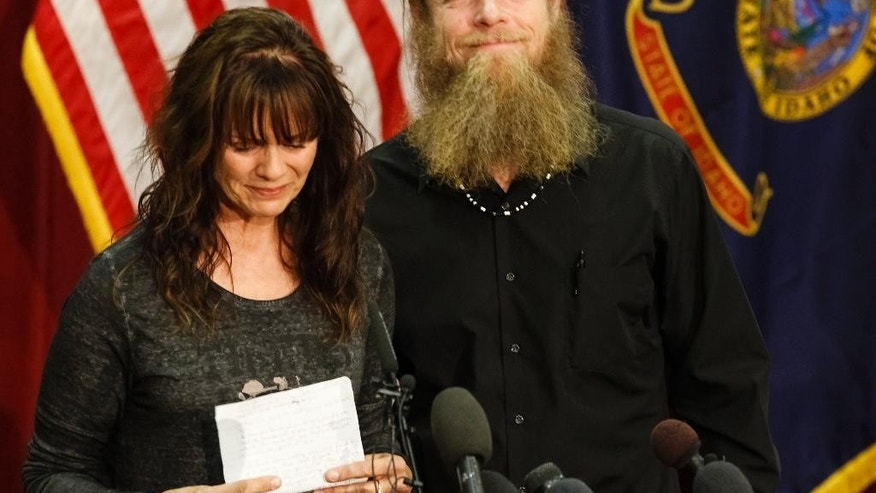 Jani and Bob Bergdahl speak to the media during a press conference at Gowen Field in Boise, Idaho, on Sunday, June 1, 2014. Bob Bergdahl, the father of an American soldier just released from captivity in Afghanistan says he's proud of how far his son, Sgt. Bowe Bergdahl, was willing to go to help the Afghan people. (AP Photo/Otto Kitsinger)