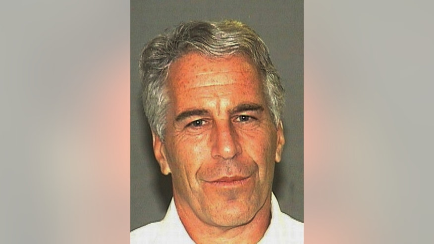 This July 27, 2006 arrest photo made available by the Palm Beach Sheriff's Office, in Florida, shows Jeffrey Epstein. Epstein was suspected nearly a decade ago of paying for sex with underage girls. The FBI abruptly dropped its investigation a few years ago, and Epstein pleaded guilty to a single state charge of soliciting prostitution. He served 13 months in jail. Now, two women who say they were sexually abused as girls by Epstein are hoping a trove of new documents will get the case reopened. (AP Photo/Palm Beach Sheriff's Office)
