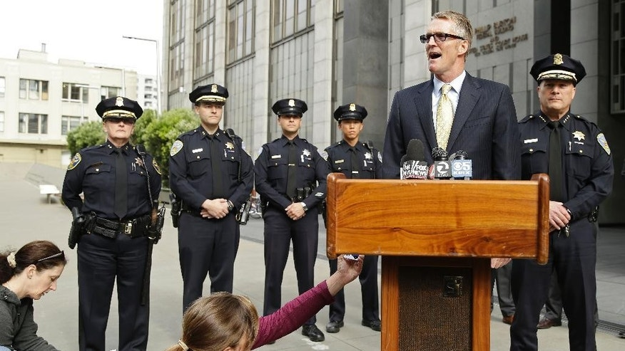 FBI Special Agent in Charge David Johnson, talks about the arrest of Ryan Kelly Chamberlain II, during a news conference outside the federal building as San Francisco Police Chief Greg Suhr, right, looks on Tuesday, June 3, 2014, in San Francisco. The San Francisco social media maven and former political consultant wanted on suspicion of possessing explosives is in FBI custody after a three-day manhunt. The San Francisco police caught Chamberlain, 42, on Monday afternoon in his car near Crissy Field, just south of the Golden Gate Bridge. (AP Photo/Eric Risberg)