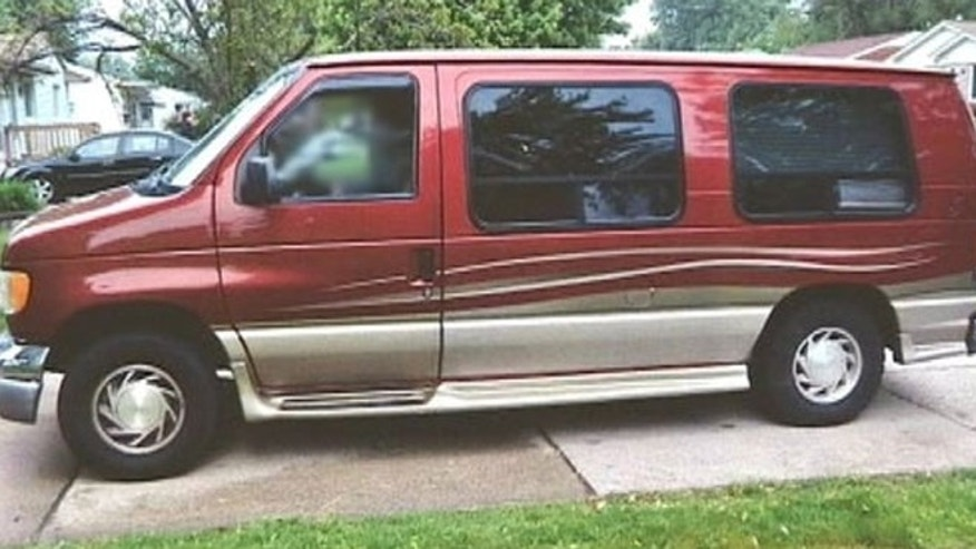 This undated image shows the van driven by the man who police say   completed a trip with a dead body in his passenger seat. (MyFoxDetroit.com)