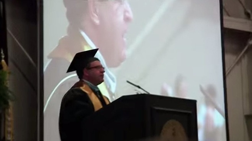 "Lebanon High School Principal Kevin Lowery reminded graduates last month that the nation's motto of ""In God We Trust"" can be found on U.S. currency and in Francis Scott Key's 1814 version of ""The Star-Spangled Banner."" Lowery also noted during the May 23 commencement that even though ""God is reflected in the very fabric"" of the nation, it would be inappropriate and even illegal to mention God or say a prayer at the ceremony. (YouTube)"