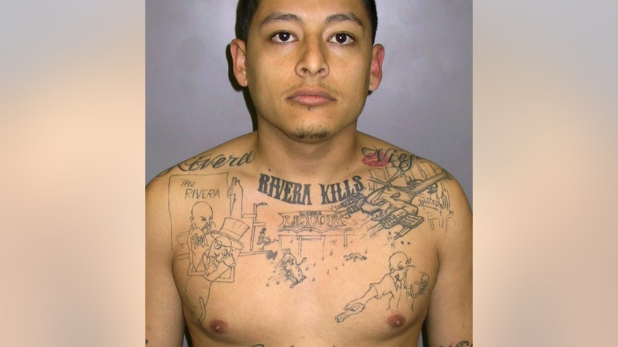 FILE - This undated file photo provided by the Los Angeles Sheriff's department shows convicted murderer Anthony Garcia, sentenced to 65 years in prison in 2011 after a homicide investigator discovered he had the scene of an unsolved 2004 murder inked on his chest.   (AP Photo/Los Angeles County Sheriff's Department, File)