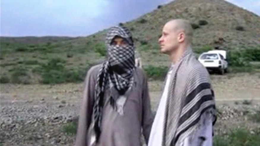 FILE - In this Saturday, May 31, 2014 image made from video obtained from the Voice Of Jihad website, which has been authenticated based on its contents and other AP reporting, U.S. Army Sgt. Bowe Bergdahl, right, stands with a Taliban member in eastern Afghanistan. On Wednesday, June 4, 2014, the Taliban released the video showing the handover of Bergdahl to U.S. forces in eastern Afghanistan.  Bergdahl went missing from his outpost in Afghanistan in June 2009 and was released from Taliban captivity on May 31, 2014 in exchange for five enemy combatants held in the U.S. prison in Guantanamo Bay, Cuba.(AP Photo/Voice Of Jihad)