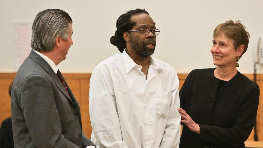 FILE - In this May 6, 2014 file photo, Robert Hill, center, stands with his lawyers Harold Ferguson, left, and Sharon Katz, right, as Justice Neil Firetog declares Hill exonerated in Brooklyn Supreme Court, in the Brooklyn borough of New York.  Prosecutors asked to throw out the decades-old convictions of three half-brothers who were investigated by homicide detective Louis Scarcella, whose tactics have come into question. The defendants, Hill, Alvena Jennette and Darryl Austin became the first people connected to the detective to be exonerated. (AP Photo/Bebeto Matthews, File)