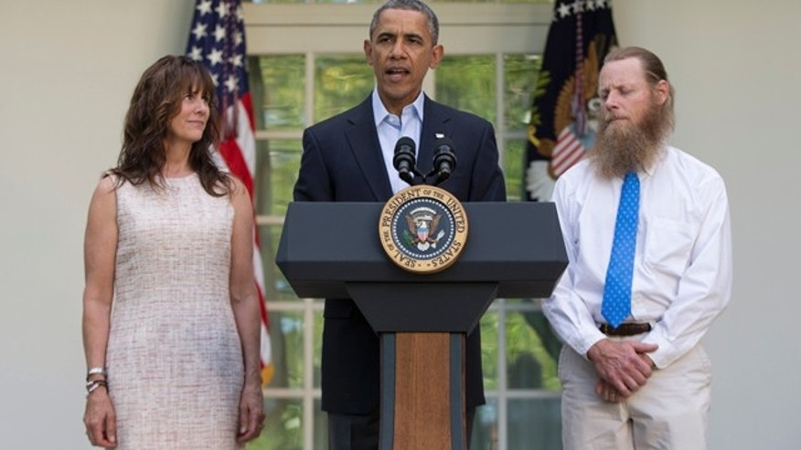 May 31, 2014: President Barack Obama speaks with Jani Bergdahl, left, and Bob Bergdahl, right, the parents of U.S. Army Sgt. Bowe Bergdahl, in the Rose Garden of the White House in Washington after the announcement that Bowe Bergdahl has been released from captivity. (AP Photo/Carolyn Kaster)