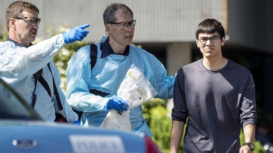 Medics attend to Jon Meis, right, after Thursday's shooting at Seattle Pacific University.