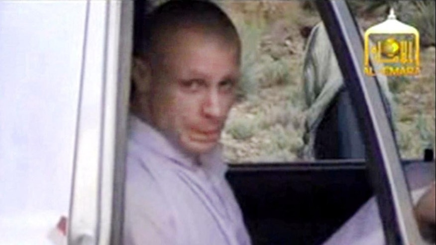 In this image taken from video obtained from Voice Of Jihad Website, which has been authenticated based on its contents and other AP reporting, Sgt. Bowe Bergdahl sits in a vehicle guarded by the Taliban in eastern Afghanistan. The Taliban have released a video showing the handover of Bergdahl to U.S. forces in eastern Afghanistan. The video, emailed to media, shows Bergdahl in traditional Afghan clothing sitting in a pickup truck parked on a hillside. Defense Secretary Chuck Hagel will face angry lawmakers Wednesday as he becomes the first Obama administration official to testify publicly about the controversial prisoner swap with the Taliban. Hagel is scheduled to appear before the House Armed Services Committee, which is investigating the deal that secured the end of Bergdahl's five-year captivity. In exchange, the U.S. transferred five high-level Taliban detainees to the Gulf emirate of Qatar.  (AP Photo/Voice Of Jihad Website via AP video)