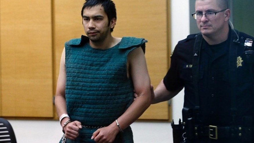June 6, 2014: Shooting suspect Aaron Ybarra, left, is led in chains to a court hearing at a King County Jail courtroom in Seattle. (AP Photo/Elaine Thompson)