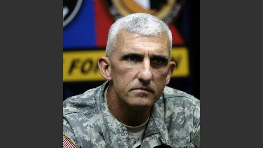 FILE - In this file photo taken on Oct. 28, 2007, then Maj. Gen. Mark P. Hertling, commander of the 1st Armored Division, talks to reporters in Tikrit, Iraq. The former top U.S. commander in northern Iraq on Thursday, June 12, 2014, defended the multibillion dollar American effort to train Iraqi security forces despite this week's Sunni insurgent offensive that has seen two key cities occupied as soldiers and police abandoned their posts. (AP Photo/Maya Alleruzzo, Pool, File)