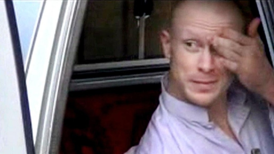 In this image taken from video obtained from Voice Of Jihad Website, which has been authenticated based on its contents and other AP reporting, Sgt. Bowe Bergdahl, sits in a vehicle guarded by the Taliban in eastern Afghanistan. A U.S. defense official says released captive Army Sgt. Bowe Bergdahl is scheduled to arrive at a military medical center in Texas on Friday. The official, who spoke Thursday on condition of anonymity because the plan has not been publicly announced, declined to provide details. Officials had previously said the intention was for Bergdahl to be reunited with his family at Brooke Army Medical Center in San Antonio. (AP Photo/Voice Of Jihad Website via AP video)