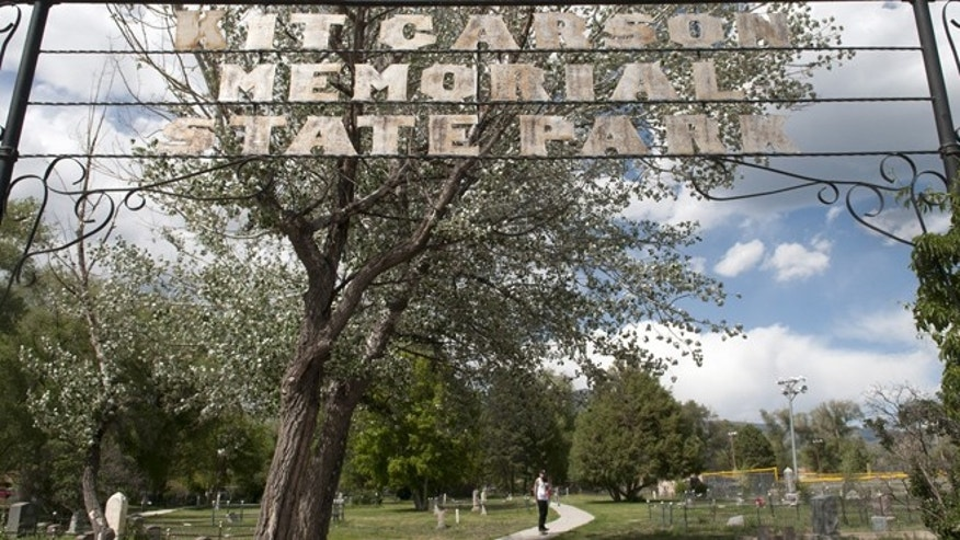 June 11, 2014: Devin Myers, from Taos, skateboards through Kit Carson Memorial Cemetery at Kit Carson Park in Taos, N.M.