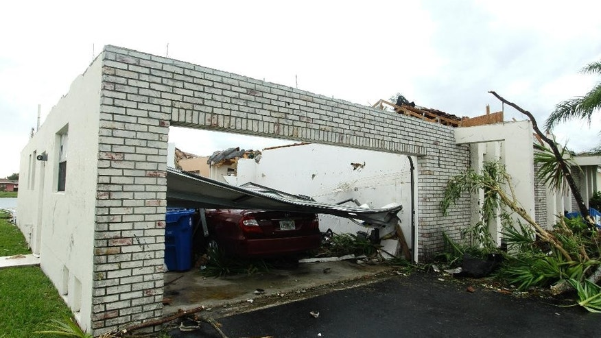 FILE - This Oct. 19, 2011 file photo shows a damaged house in Sunrise, Fla. after a possible tornado damaged more than two dozen houses in the area. Oklahoma and Kansas may have the reputation as tornado hotspots, but Florida and the rest of the Southeast are far more vulnerable to killer twisters, a new analysis shows. (AP Photo/J Pat Carter, File)