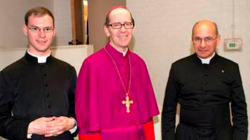 From the left, Fr. Kenneth Walker, Bishop Thomas J. Olmsted of the Diocese of Phoenix and Fr. Joseph Terra, are seen here in this undated photo.