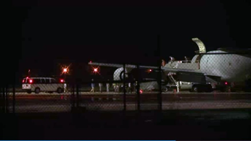In this image from video, people are greeted on arrival at Lackland Air Force Base near San Antonio, early Friday morning June 13, 2014. Bowe Bergdahl, the Army sergeant who has been recovering in Germany after five years as a Taliban captive, returned to the United States on this plane to continue his medical treatment. (AP Photo/Manis Calco)
