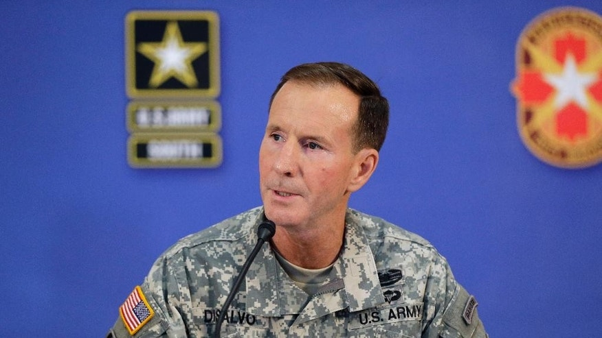 U.S. Army South Commander Maj. Gen. Joseph P. DiSalvo  answers a question during a news conference regarding Sgt. Bowe Bergdahl and the Phase III Reintegration process, Friday, June 13, 2014, in San Antonio, Texas. Bergdahl, the Army sergeant who has been recovering in Germany after five years as a Taliban captive, returned to the United States early Friday to continue his medical treatment at Brooke Army Medical Center in San Antonio. DiSalvo is in charge of Bergdahl's Phase III Reintegration at the facility. (AP Photo/David J. Phillip)