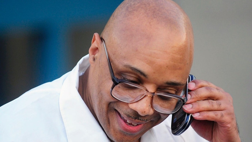 FILE: Andre Davis speaks with his mother on a cell phone outside the Tamms Correctional Center in Tamms, Ill., after being released from prison after serving 32 years before DNA evidence overturned his 1980 conviction in the rape and murder of 3-year-old Brianna Stickle of Rantoul, Ill.