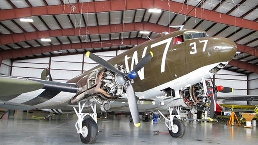 Whiskey 7 is a Douglas C-47 that dropped troops behind enemy lines in France during D-Day. The warplane has been restored and housed at the National Warplane Museum in Geneseo, N.Y. It will return to France in June to re-create its role in the D-Day invasion. (AP)