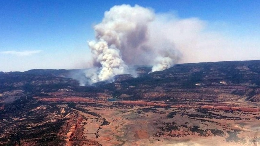 June 15, 2014: This image provided by Inci Web shows a plume of smoke in the Chuska Mountains near Naschitti, N.M. (AP Photo/Inciweb)
