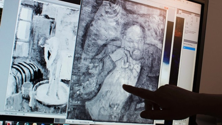 "Patricia Favero, associate conservator at The Phillips Collection, points to an image of a man found underneath one of Picasso's first masterpieces, ""The Blue Room"""
