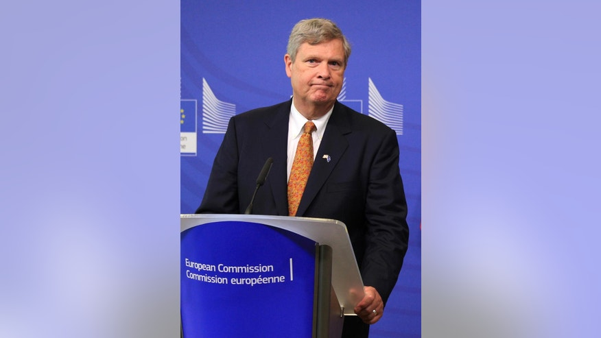 U.S. Secretary of Agriculture Tom Vilsack addresses the media at the European Commission headquarters in Brussels, Tuesday, June 17, 2014. (AP Photo/Yves Logghe)