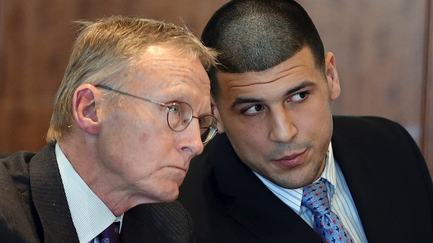 Feb. 7, 2014: Former New England Patriots football player Aaron Hernandez, right, speaks to his attorney Charles Rankin during a hearing at Bristol Superior Court, in Fall River, Mass. (AP/The Boston Globe, Jonathan Wiggs, Pool, File)