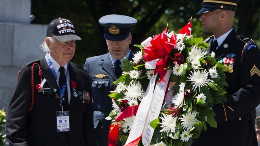 June 6: D-Day veteran Herman Zeitchik, left, lays a wreath during a ceremony to mark the 70th anniversary of the D-Day landings at the World War II Memorial in Washington.