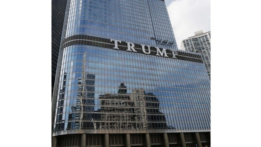 June 12, 2014: Newly installed 20-foot-tall letters spelling out T-R-U-M-P stand on the side real estate billionaire Donald trump's skyscraper in Chicago.