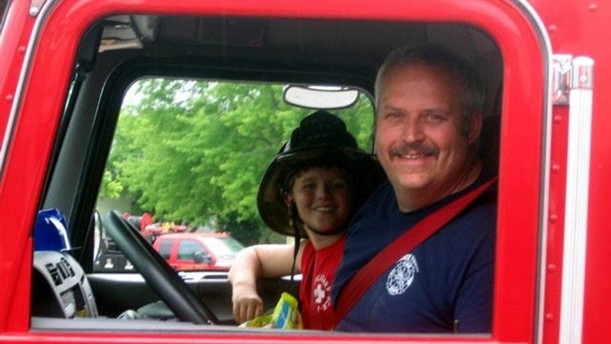 June 19, 2014: This image provided by Gallitan County Fire Department shows Chief Todd Rummel, who was killed in an accident Thursday after a fire engine and a pickup truck collided on a Montana highway, with an unidentified passenger (AP Photo/Gallitan County Fire Department)