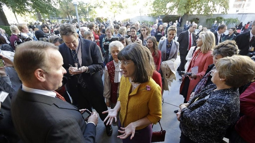 Oct. 5, 2013: In this file photo, Kate Kelly, center, with a group of about 200 feminist women, is denied entrance to an all-male meeting of Mormon priesthood during the Mormon church conference, in Salt Lake City. (AP)