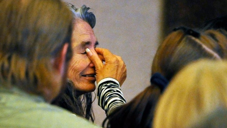 Debra Wilcox, mother of Joseph Wilcox, wipes her eyes during a memorial service at Palm Downtown Mortuary on Sunday, June 22, 2014, in Las Vegas. Wilcox went for his own legal and concealed handgun after a couple killed Officers Igor Soldo and Alyn Beck at a nearby pizza shop and walked into a Wal-Mart, fired a shot in the air, and declared the start of a revolution two weeks ago. (AP Photo/Las Vegas Review-Journal, David Becker, Pool)