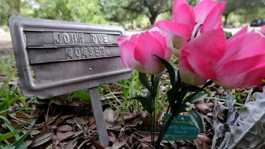 "June 25: A marker with ""John Doe"" marked the grave of an unidentified immigrant at a cemetery in Falfurrias, Texas."