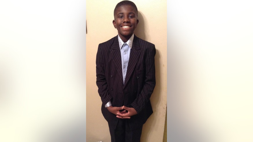 This photo provided by the Detroit Police Department shows Charlie Bothuell V, 12, of Detroit, who has been missing since June 14. Bothuell has been found alive in his father's basement. Detroit police spokesman Sgt. Mike Woody says officers were serving a search warrant at the home near downtown, on Wednesday, June 25, 2014,  when they stumbled upon Bothuell. (AP Photo/Courtesy Detroit Police Department)