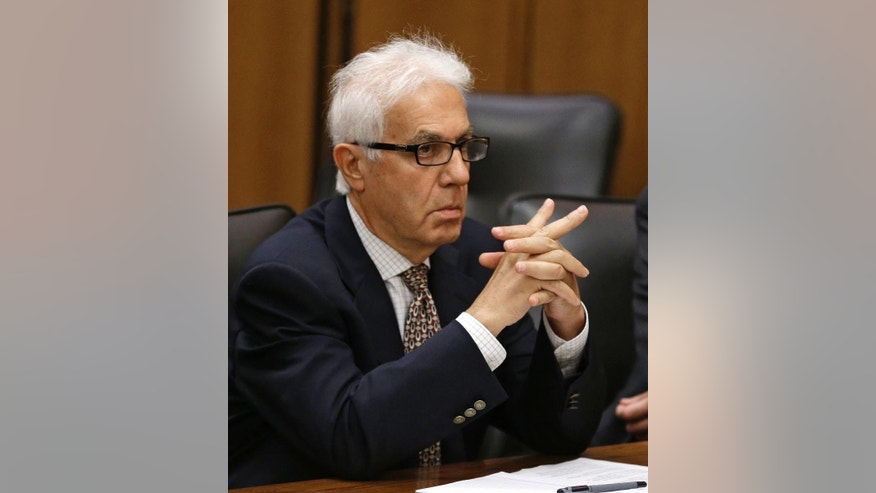 Dr. Georges Bensimhon listens to court proceedings during his sentencing phase Tuesday, July 1, 2014, in Cleveland. Bensimhon, a Pennsylvania anesthesiologist, was sentenced to 3 years in prison for what prosecutors believe was an attempt to kill his son-in-law, who also is a doctor, in a Cleveland suburb in September 2013. Bensimhon pleaded guilty to a single count of felonious assault in April. (AP Photo/Tony Dejak)
