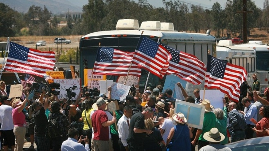 July 1, 2014: Protesters turn back three buses carrying 140 immigrants as they attempt to enter the Murrieta U.S. Border Patrol station for processing.