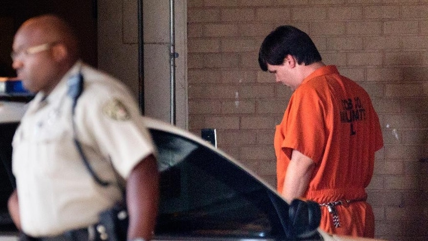 Justin Ross Harris, right, the father of a toddler who died after police say he was left in a hot car for about seven hours, arrives for his bond hearing at Cobb County Magistrate Court Thursday, July 3, 2014, in Marietta, Ga. Harris is currently being held without bond on a child cruelty charge and a murder charge. (AP Photo/David Goldman)