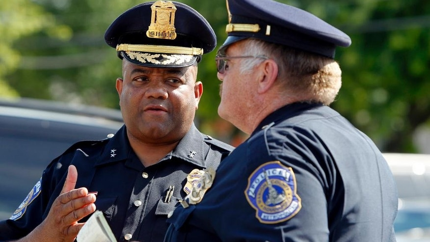 Indianapolis Police Chief Rick Hite, left, speaks with a lieutenant after a news conference on the seven-victim shooting in the Broad Ripple neighborhood of Indianapolis on Saturday, July 5, 2014. The shooting in the bar-hopping neighborhood may have been set off by two people bumping into each other in the street, police said Saturday. (AP Photo/The Indianapolis Star, Anna Reed)
