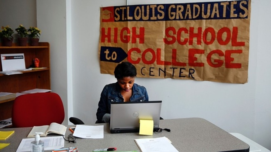 June 10, 2014: This photo shows intern Daisha Tanking working at the St. Louis High School to College Center in St. Louis. A drop-in counseling center akin to a pop-up retail store, the center helps low-income students make the transition to college by negotiating financial aid agreements, housing contracts and the other myriad details of college enrollment.